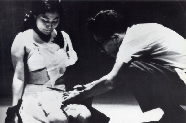 Yoko Ono: Cut Piece, photo of performance, July 20, 1964 (Kyoto, Yamaichi Hall); photo courtesy of Lenono Photo Archive ©Yoko Ono