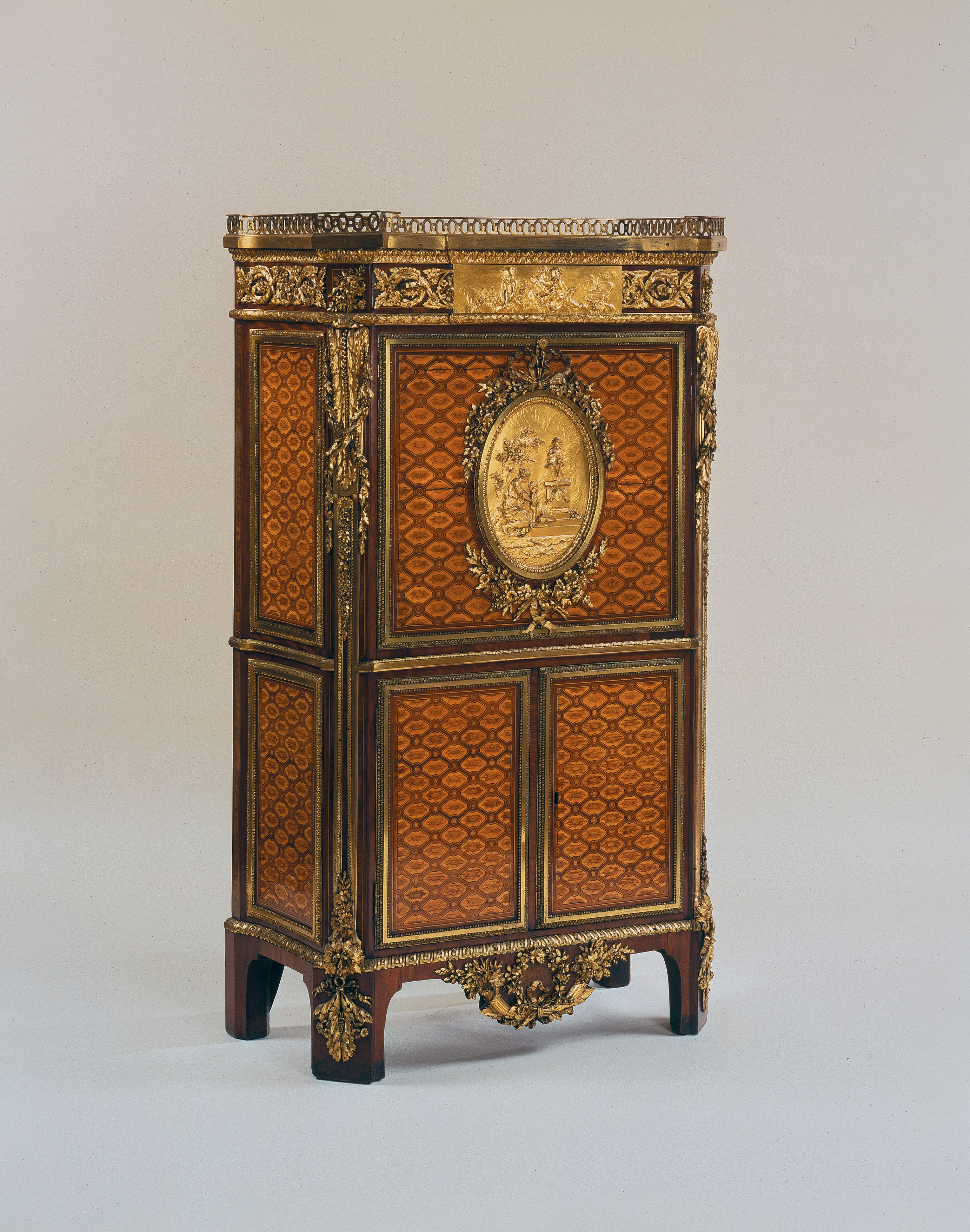 Secretaire, Jean-Henri Riesnener, Oak veneered with satiné, sycamore, ebony, box, amaranth, burr walnut and tulipwood; Carrara marble, gilt bronze, leather and brass, 139.6 x 80.5 x 42 cm, 1783 (London: The Wallace Collection, Object No. F302), image courtesy of The Wallace Collection
