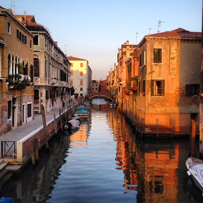 Sunset over a Venetian canal, via Wikimedia Commons; photo credit: *christopher*