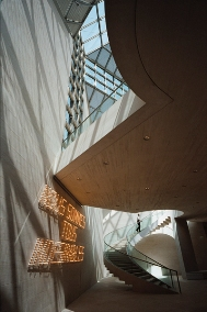 Interior of Musée d'Art Moderne Grand-Duc Jean by I. M. Pei (2006),artwork by Fernando Sanchez Castillo: Nous sommes tousindésirables, 2004 (Luxembourg, MUDAM Collection); photo byPierre-Olivier Deschamps / Agence Vu, © MUDAM Luxembourg